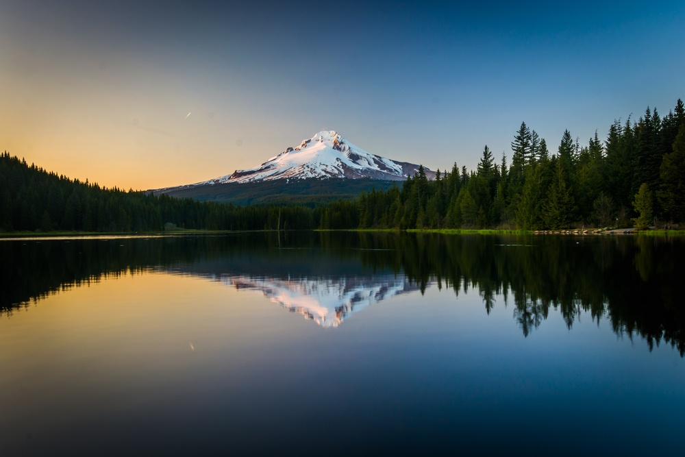 Mount Hood reflecting in Trillium Lake at sunset, in Mount Hood National Forest, Oregon.
