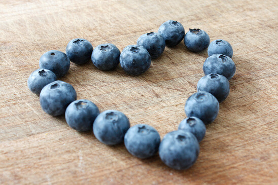 How to Fight the Flu in the Elderly — Blueberries arranged into the shape of a heart